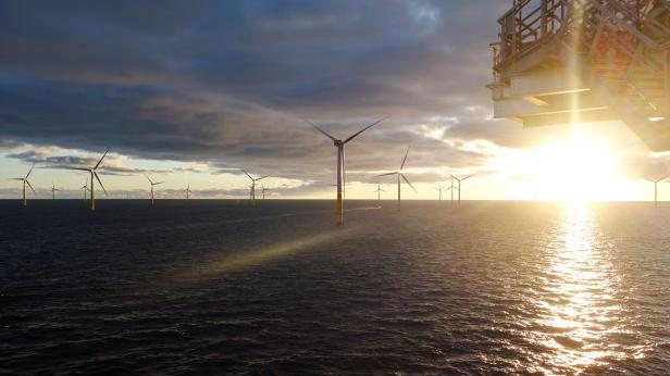 Offshore windfarm at sun set