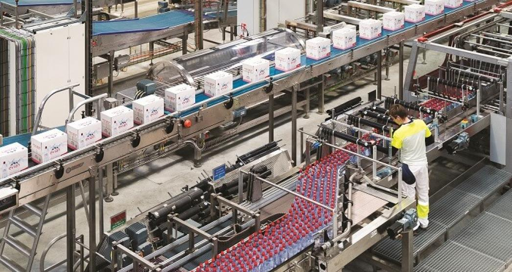Inside a factory showing boxes and bottles of water