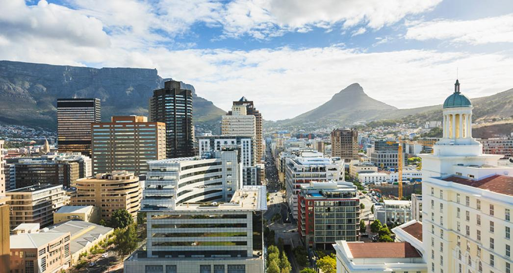 View of South African city with high rise buildings and mountains in the background