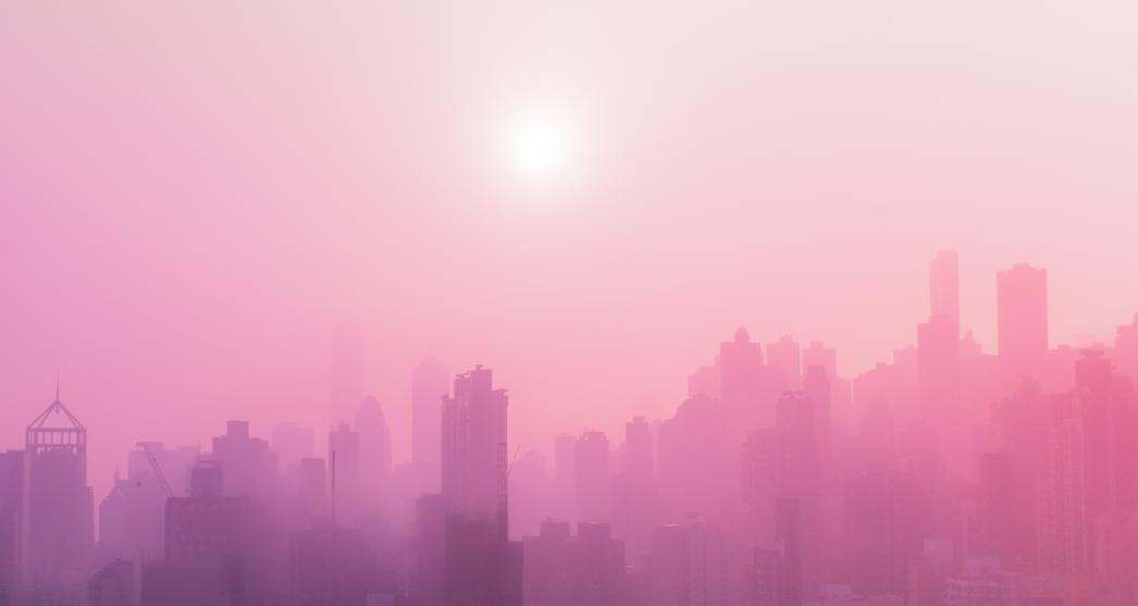 pink misty city skyline with buildings