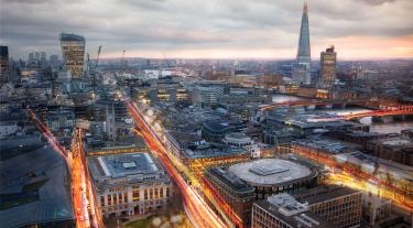 view of London cityscape at dusk with roads lit up