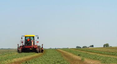 image showing a tractor in a field