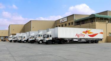 Agility lorries in a row by their building