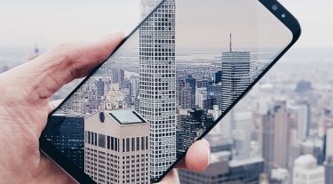 Samsung Galaxy taking picture of skyscrapers