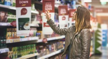 Woman choosing products in supermarket