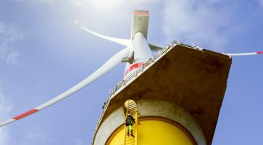 Manual high worker climbing on wind-turbine