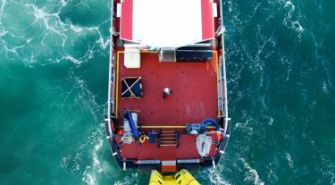 Offshore transfer vessel pushing on wind-turbine