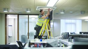 man working on the roof of an office