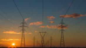 image showing electricity pylons at sunset