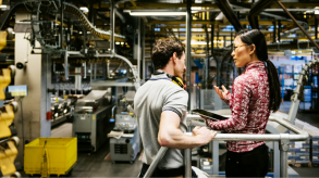 Man and woman talking in factory