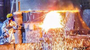 Figure welding metal with huge sparks
