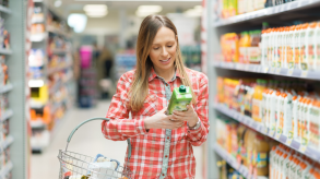 Product labelling woman in supermarket