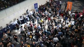 image of attendees mingling at a large event