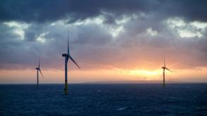 Offshore wind-farm in sunset and clouds