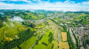 Aerial view of suburban homes and green fields in the UK