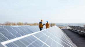 Man and woman inspecting solar panels