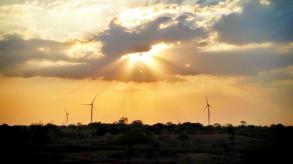 Sun shining on wind turbines